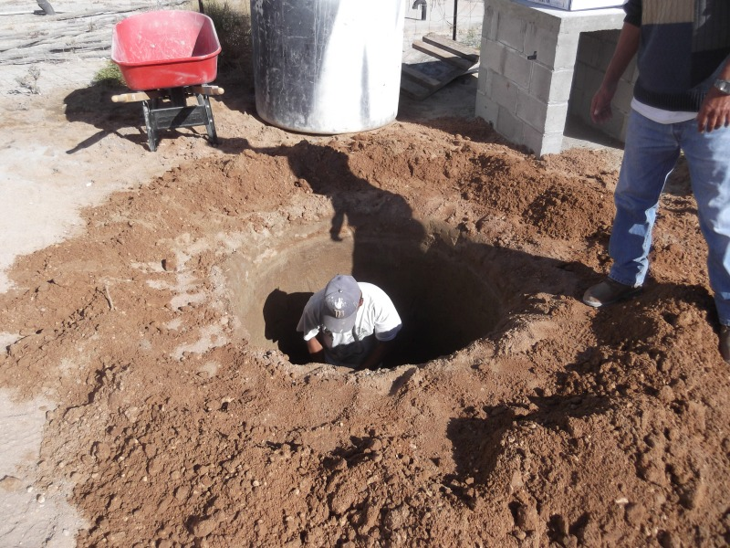 Digging the hole for the grey tank