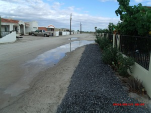 Puddle in front of the house new gravel in front of the house