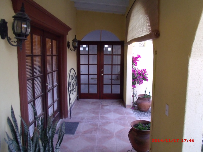 Looking down the veranda to the entrance to the Sala