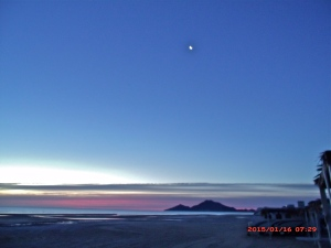 Beach at dawn with the moon still up