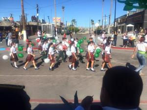 Little school kids are parading too